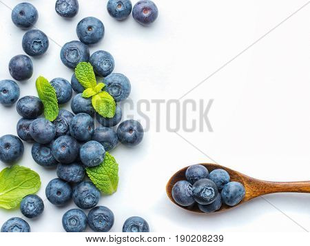 poster of Blueberries isolated on white background. Blueberry border design. Ripe and juicy fresh picked bilberries close up. Copyspace. Top view or flat lay