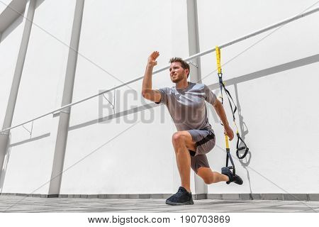 poster of Fitness suspension straps man training legs with suspended lunge exercise at gym. Lower body workout