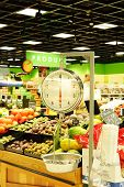 image of grocery store  - A weight scale in a produce section of a grocery store - JPG