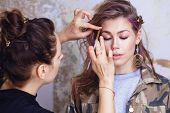 Make-up Artist And Model At Work poster