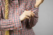 Woman Rolling Up The Sleeves In Checked Shirt poster