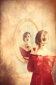 Young Woman Looking At Mirror poster