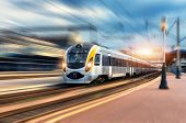 High Speed Train In Motion At The Railway Station At Sunset poster