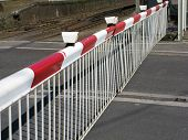 stock photo of safety barrier  - Automatic rail barrier blocking traffic on the roads - JPG