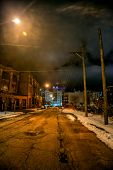 Industrial winter street city night scene with vintage factory warehouses and the Chicago skyline poster