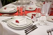 image of wedding table decor  - Table setting with plates and silverware  - JPG