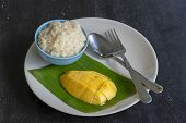 Thai Style Dessert, Mango With Sticky Rice On Plate. Yellow Mango And Sticky Rice Is Popular Traditi poster