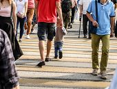 People In The City Cross The Road At A Pedestrian Crossing . poster