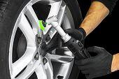 Car Polish Wax Worker Hands Polishing Car Wheel. Buffing And Polishing Car Disc. Car Detailing. Man poster