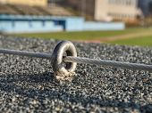 Steel Twisted Rope And Steel Bolt Anchor Eye In Concrete Base. The End Knot Of Steel Rope. poster