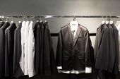 picture of lapel  - Row of suits in shop - JPG
