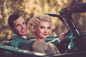 Retro couple in convertible