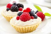 foto of pie-in-face  - tartlets with fruits and berries - JPG