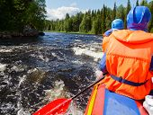 stock photo of rafters  - Rafters in a rafting boat on Pistojoki river in Karelia - JPG