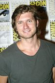 SAN DIEGO, CA - JULY 15: Tom Weston-Jones arrives at the 2012 Comic Con convention press room at the