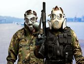 stock photo of chemical weapon  - Portrait Of Soldiers With Gun And Gas Mask - JPG