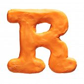Plasticine letter R isolated on a white background
