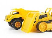 Постер, плакат: Желтые пластиковые Детские игрушки бульдозер и самосвал изолированные на белом фоне