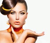 stock photo of barber  - Fashion Model Girl Portrait with Yellow and Orange Makeup - JPG