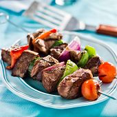 stock photo of braai  - grilled beef shishkabobs on table close up - JPG
