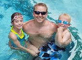 foto of father time  - Family playing in the swimming pool together - JPG