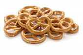 stock photo of biscuits  - a pile of crispy pretzels on white background - JPG