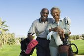 image of golf bag  - Portrait of happy senior couple in golf course smiling - JPG