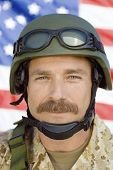 foto of military personnel  - Closeup portrait of a soldier with moustache in front of United States flag - JPG