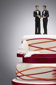 stock photo of figurines  - Groom Figurines on Wedding Cake - JPG