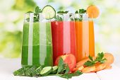 pic of root vegetables  - Fresh vegetable juices on wooden table - JPG