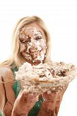 foto of pie-in-face  - A woman has pie all over her face and is very messy - JPG