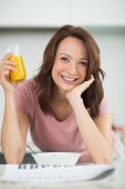 foto of medium-  length hair  - Smiling young woman with a bowl of cereals - JPG