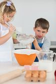 picture of flour sifter  - Cute children baking cookies together at kitchen counter - JPG