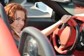 Young Beautiful Woman In Sport Car