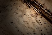 foto of clarinet  - Musical notes and clarinet on wooden table - JPG