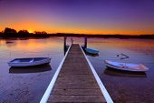 image of pontoon boat  - Little boats moored to a jetty at sunset - JPG