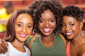 three african college friends closeup portrait