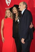 LOS ANGELES - JAN 24: Caroline Smedvig, Steven Tyler, James Taylor at the 2014 MusiCares Person Of T