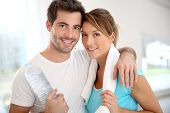 stock photo of 35 to 40 year olds  - Portrait of smiling couple in fitness gym - JPG