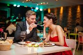 foto of amor  - Lovely young couple eating on romantic dinner - JPG