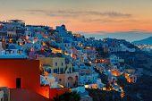stock photo of greek-island  - A beautiful sunrise over Oia on Santorini island, Greece ** Note: Shallow depth of field - JPG