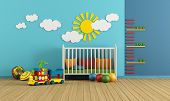 stock photo of wall cloud  - Child room with baby crib and toys  - JPG