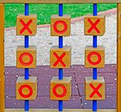 pic of tic  - wooden tic tac toe in a green park - JPG