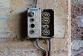 stock photo of contactor  - Old electrical panel on a concrete wall - JPG