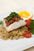 picture of halibut  - Baked halibut with olive tapenade crust garnished with couscous fried cherry tomatoes and fresh parsley - JPG