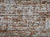 picture of mortar-joint  - An old brick wall with open mortar joints - JPG