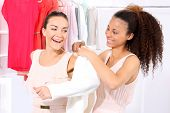 stock photo of covenant  - Two women shopping in boutique clothing - JPG
