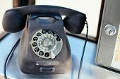 picture of phone-booth  - Traditional and very worn rotary phone in phone booth - JPG