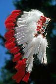 picture of headdress  - Closeup of a Native American feathered war bonnet also called warbonnet or headdress - JPG