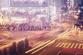 picture of intersection  - People and vehicles cross the famously busy Shibuya intersection in Tokyo - JPG